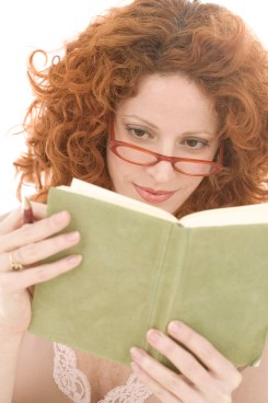 Woman Reading a Diary --- Image by © Royalty-Free/Corbis