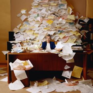 cluttered freelance editor desk