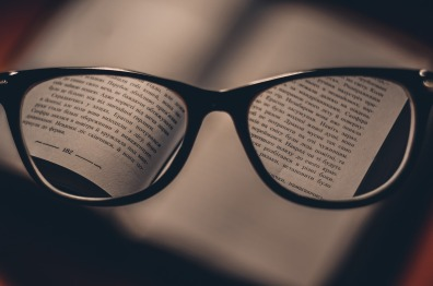 glasses highlighting a book