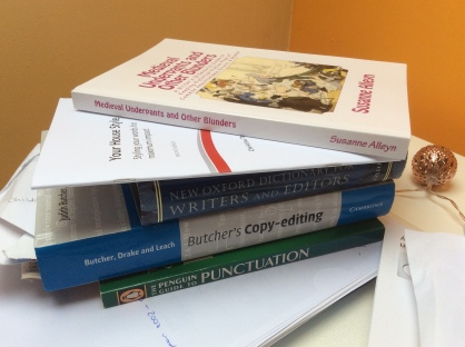 an editor's desk, reference books