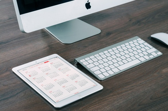 imac, ipad, desk and calendar