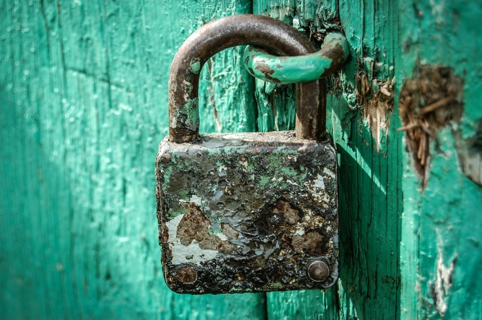 padlock on beautiful turquoise door