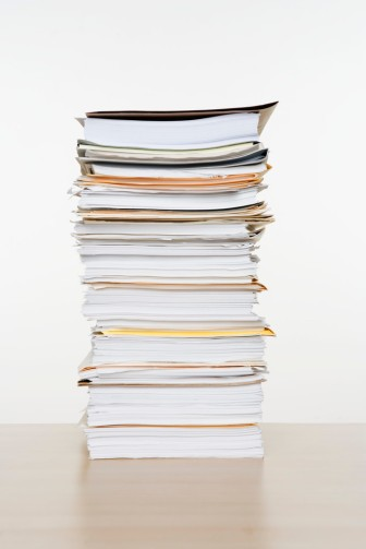 stack of documents, books, writing