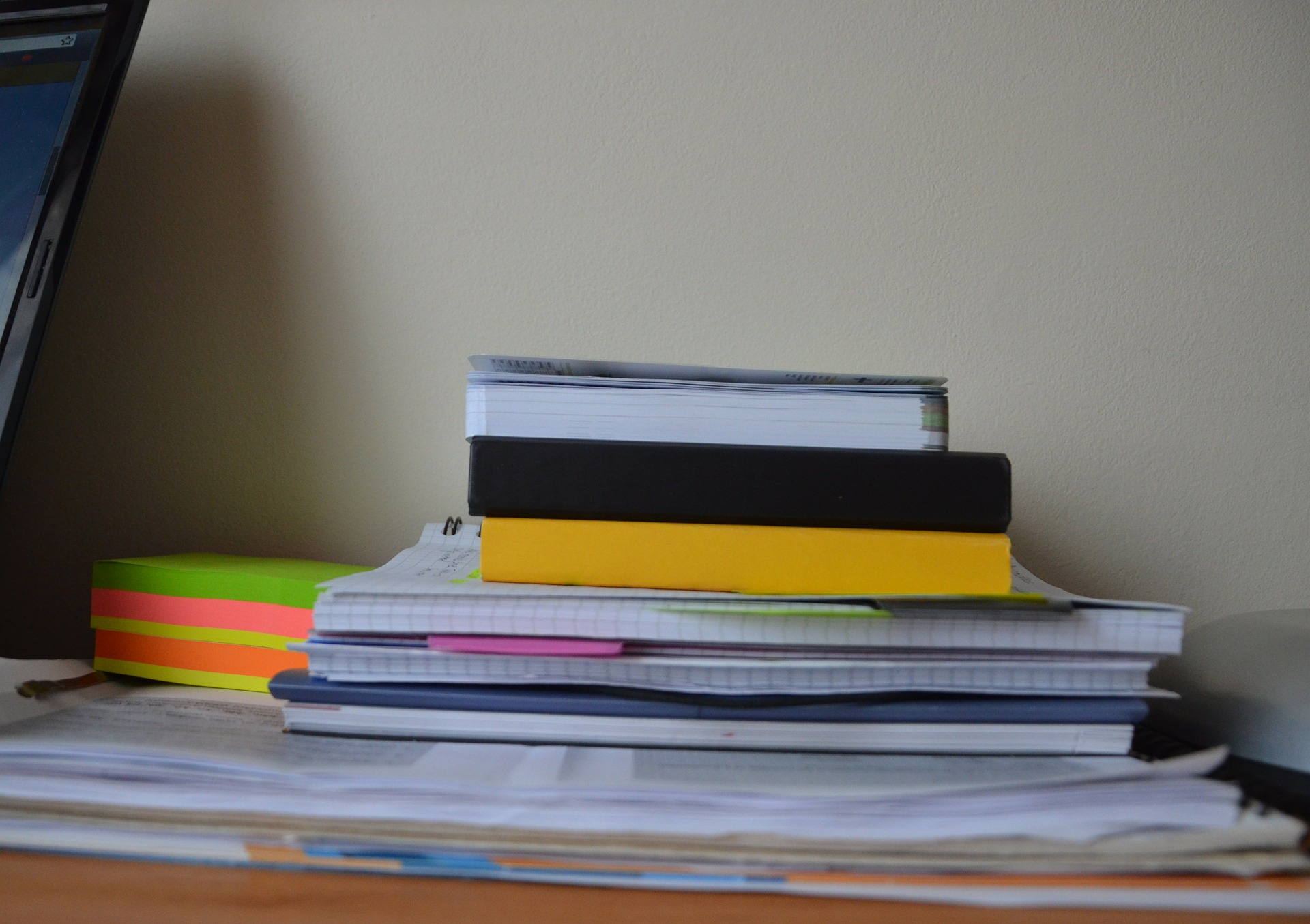 stack of papers and notebooks