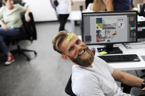 Happy businessman designer